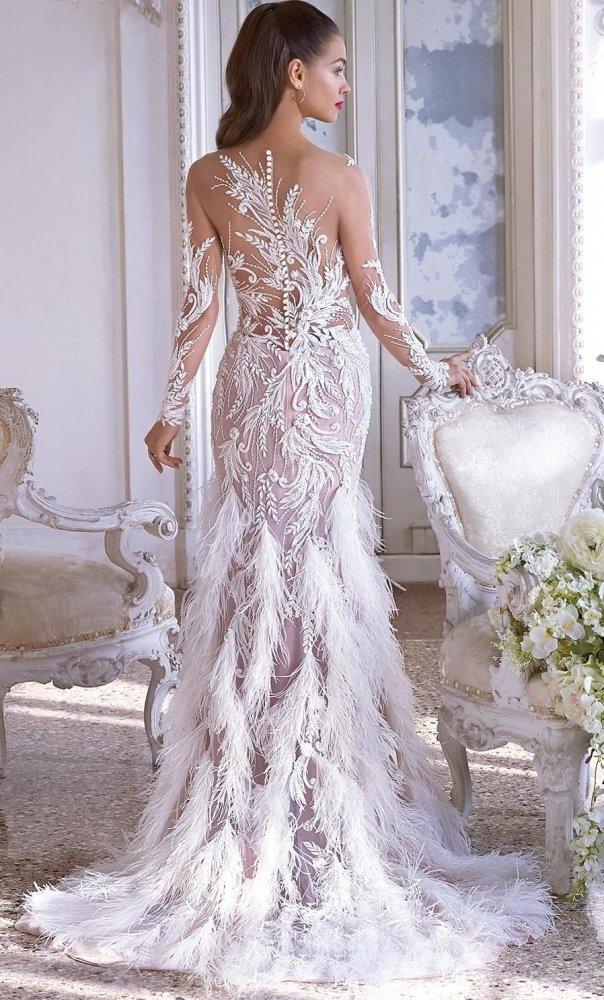 f7290dc00 موديلات فساتين زفاف بأكمام شفافة لعروس 2019 - مجلة هي