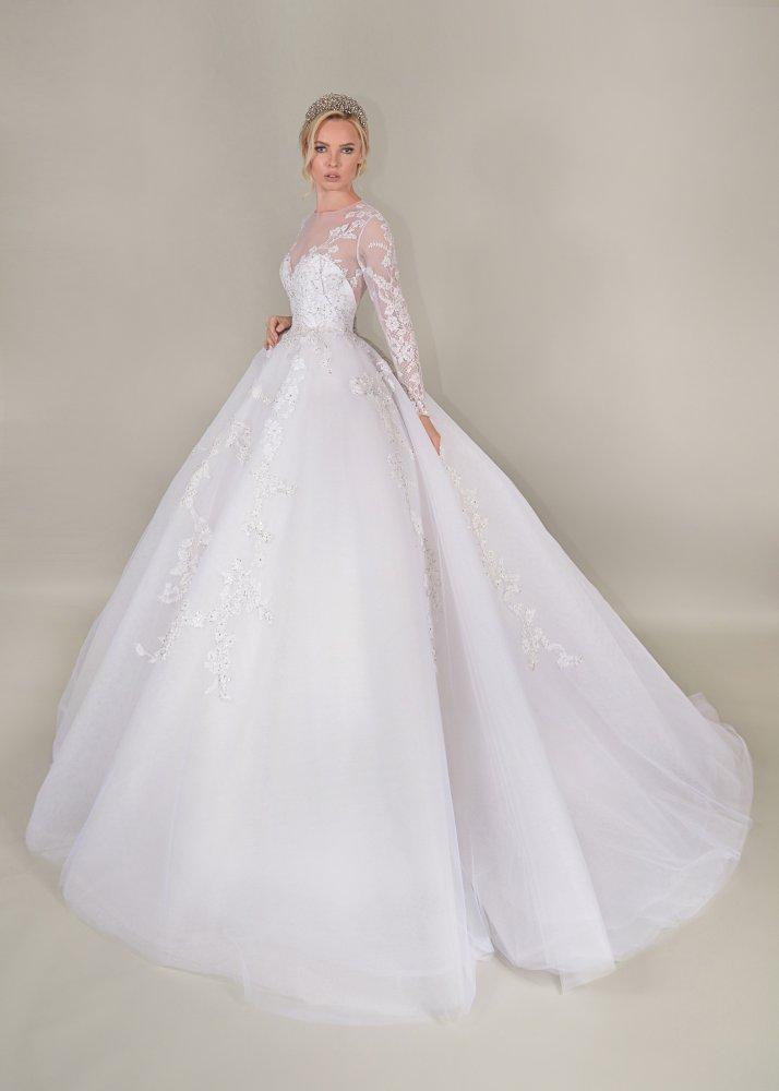 1660bf55d فساتين زفاف هادئة من مجموعة توفيق حطب - مجلة هي